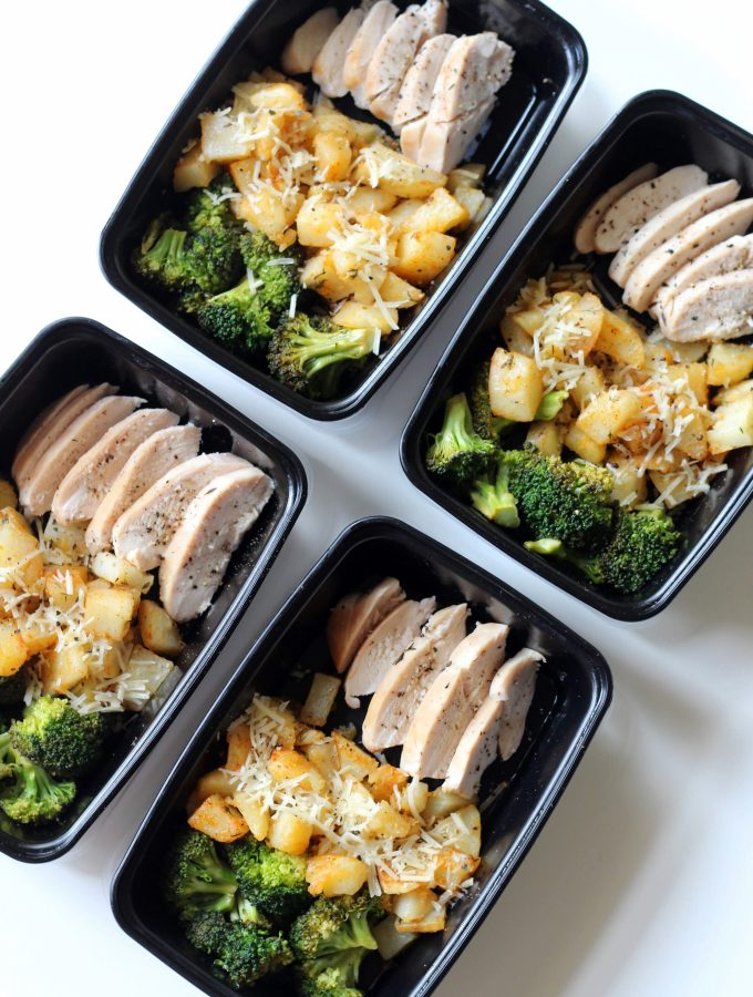 Containers with chicken, diced potatoes, and broccoli.