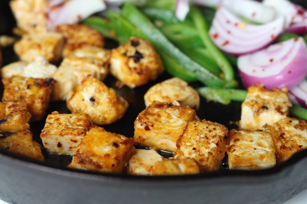 Crispy Tofu in Pan with Bell Peppers and Onions
